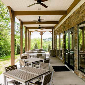 Stay cool in the shade in one of our outdoor seating areas.